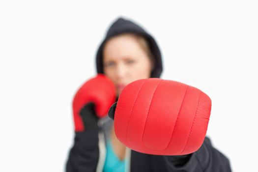 Woman fuzzy showing a boxing glove
