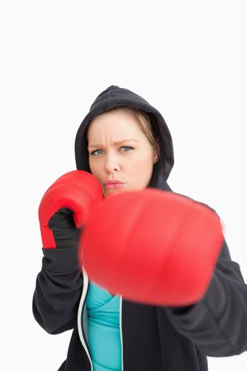 Concentrated woman boxing