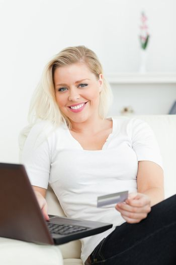 Casual woman using a laptop for e-commerce