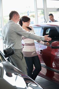 Woman looking at a car interior