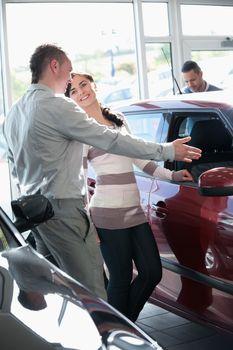 Woman talking with a salesman