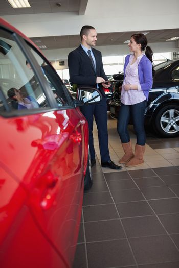 Woman smiles as she talks with a salesman