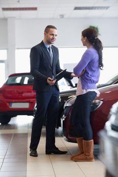 Salesman talking to a customer