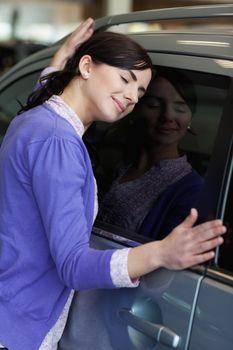 Woman hugging a car