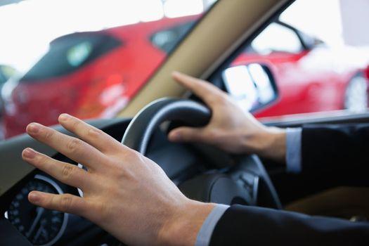 Man holding a steering wheel