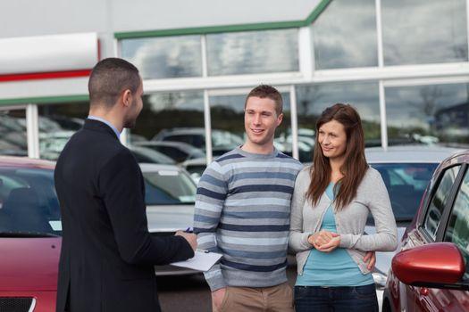 Salesman talking to a couple