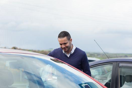 Buyer looking inside a car
