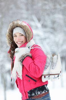 Beautiful Asian woman holding ice skates