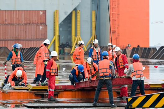 LAEM CHABANG - OCTOBER 2: Workers preparing for shipment of the 6,000 ton Gudrun module for shipment from Thailand to Norway in Laem Chabang, Thailand on October 2, 2012.