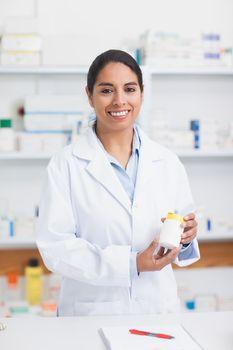 Pharmacist holding a drug box
