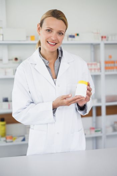 Pharmacist presenting a drug box