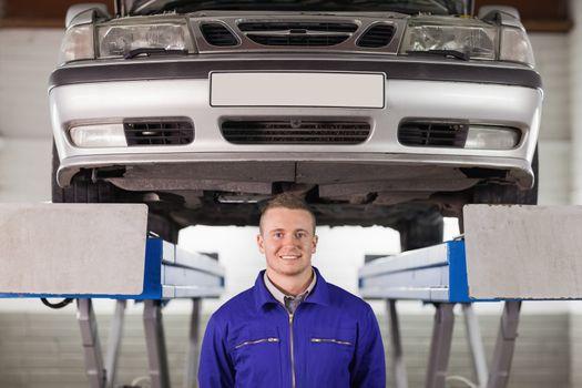 Mechanic below a car