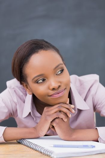 Close up of a thoughtful black woman in a classroom