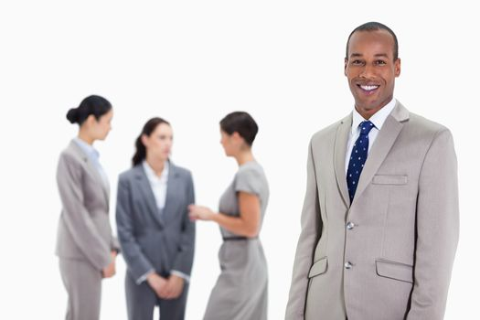 Businessman with co-workers talking in the background