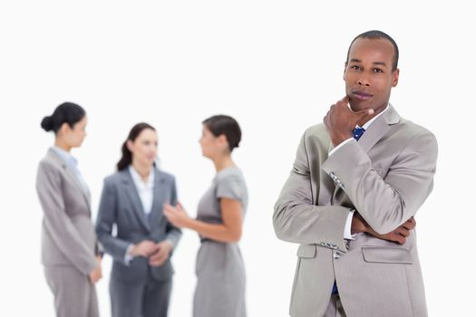 Thoughtful businessman with co-workers