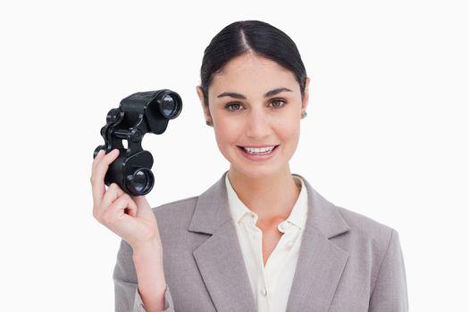 Businesswoman with spy glasses
