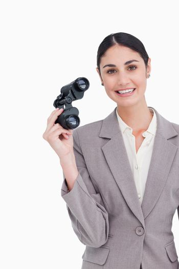 Smiling businesswoman with spy glasses