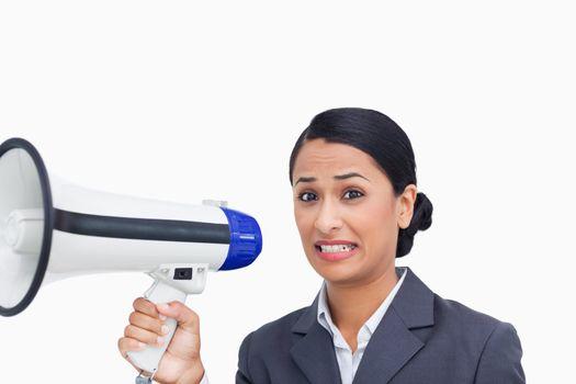 Close up of afraid saleswoman with megaphone