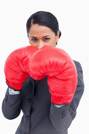 Close up of belligerent saleswoman with boxing gloves