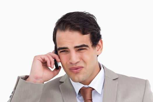 Close up of annoyed salesman on his cellphone