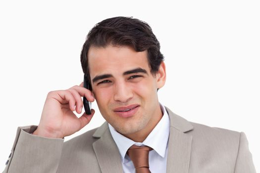 Close up of irritated salesman on his cellphone