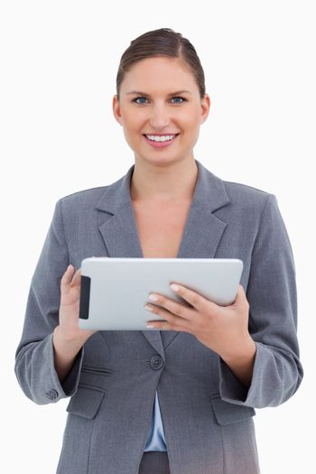 Smiling tradeswoman with her touchscreen computer