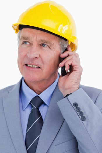 Close up of mature architect talking on the phone