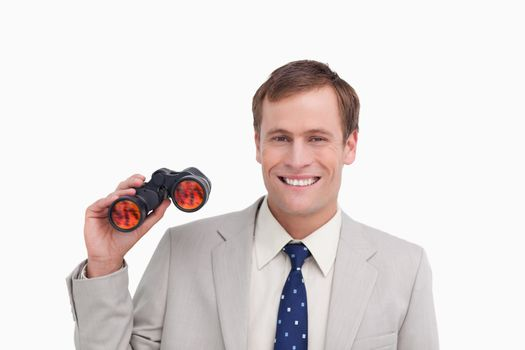 Smiling businessman with spy glasses