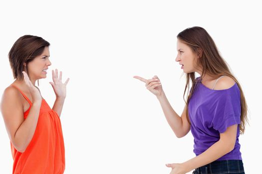 Teenager blaming her friend who is claiming her innocence