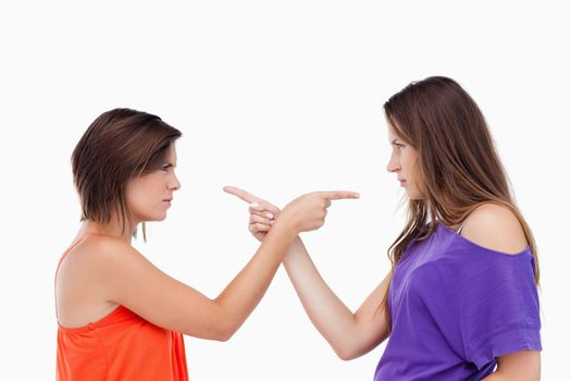 Teenagers pointing fingers on each other