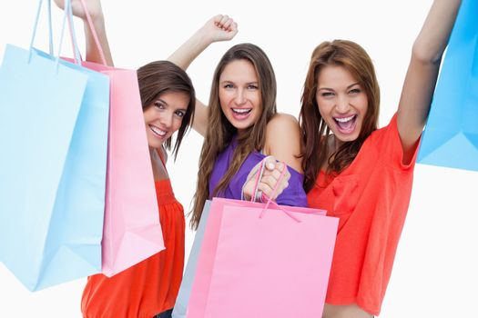 Young women elevating their purchase bags