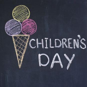 """""""Children's day""""  written by a chalk on a blackboard"""