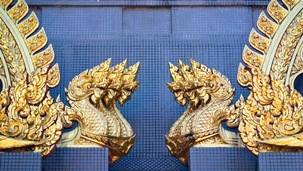 Sculptures of golden dragons on the wall