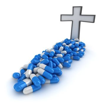 Cross on the grave made from pills