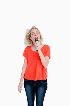 Dynamic teenager singiing karaoke