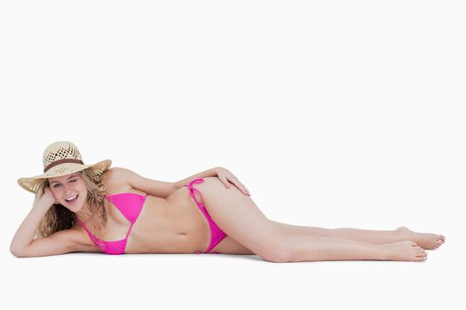 Young attractive woman in side lying position while blinking an
