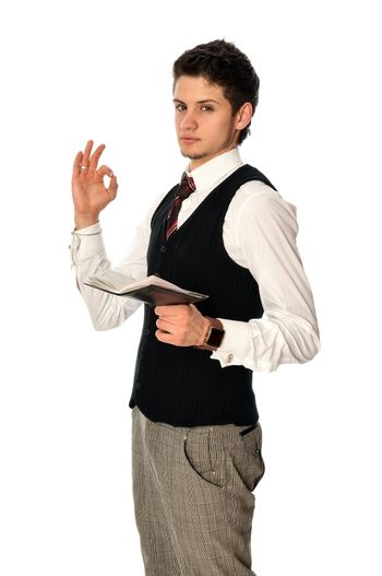 businessman writing a daily plan of action in his notebook