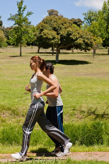 Woman and a man jogging side by side