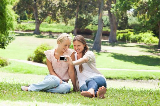 Friends taking pictures of themselves