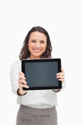 Portrait of a brunette showing a touchpad screen