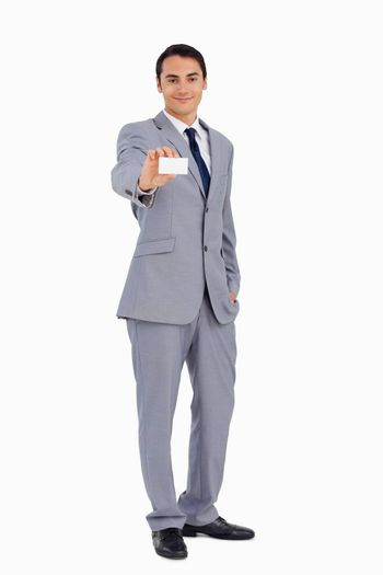 Good-looking man showing his business card