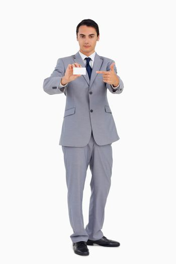 Good-looking man showing and pointing his business card
