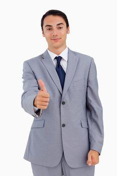Close-up of a good-looking man the thumb-up
