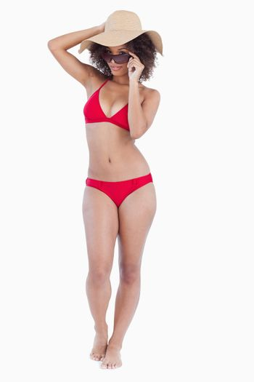 Beautiful woman standing upright in beachwear