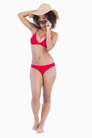 Attractive young woman standing upright in swimsuit