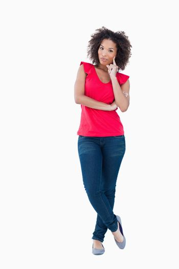 Young thoughtful woman standing upright