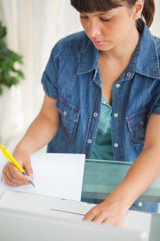 Unsmiling student doing her homework