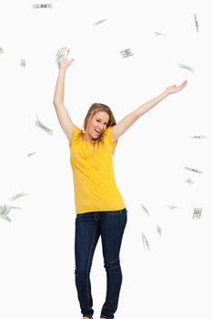 Beautiful blonde woman tossing dollars
