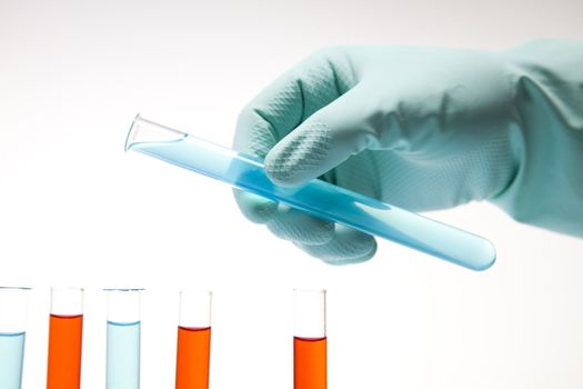 Scientist working in a laboratory , glass containing liquid color