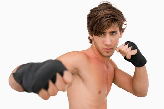 Martial arts fighter attacking with his fist